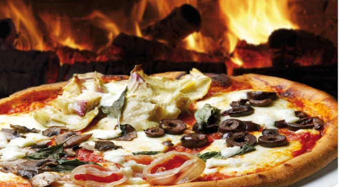pizza cooked in a wood oven