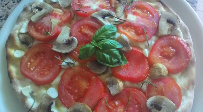 Focaccia with tomato slices Mushrooms and Garlic