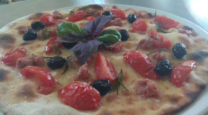 Focaccia with tomatoes Sausage and Black Olives