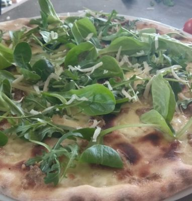 Pizza with Pesto Olive and Almond Arugula and Grana