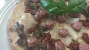 Pizza With Mushrooms Dried Tomatoes Onion Sausage Lucanica
