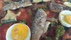 Pizza With turnip tops zucchini peppers Sardines Egg Sodo