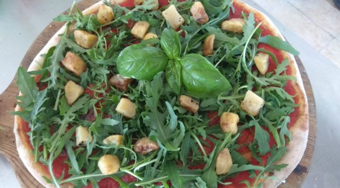 Pizza with anchovies, rocket and potatoes