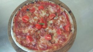 Pizza With Bacon Ham and Cherry Tomatoes