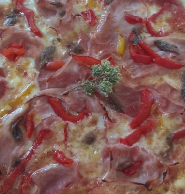 Pizza With Ham, Peppers and Anchovies